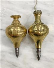 Sale 8951P - Lot 337 - Brass TurnipForm Plumb Bobs x 2, largest marked AM1941 (9cm)