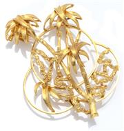 Sale 9046 - Lot 332 - A 10.6CT GOLD BROOCH; fashioned as palm trees with open trefoil background, size 55.6 x 42.7mm, wt. 11.47g.