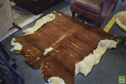 Sale 8390 - Lot 1301 - Tan Cow Hide