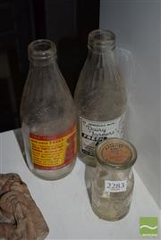 Sale 8509 - Lot 2283 - 2 Dairy Farmers Milk Bottles with Advertising & Camden Vale Quarter Pint Cream Bottle with Lid