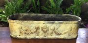 Sale 8706A - Lot 25 - A large cream colour cast iron oval planter with roman urn motif, general wear, surface rust, H 15 x L 59cm