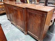 Sale 8939 - Lot 1051 - Large Regency Mahogany Breakfront Cabinet, with four panel doors enclosing fully adjustable shelves, flanked by rope-twist fascia (f...