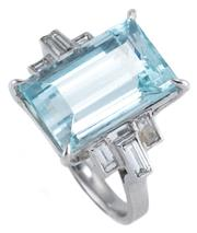 Sale 8954 - Lot 364 - AN 18CT WHITE GOLD AQUAMARINE AND DIAMOND RING; four claw set with a modified rectangular cut aquamarine of approx. 9ct to shoulders...