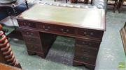 Sale 8402 - Lot 1038 - Georgian Style Mahogany Double Pedestal Desk, with green tooled leather top & nine drawers