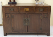 Sale 8677B - Lot 541 - An oriental style cabinet of three short drawers over two cupboard drawers, flanked by two smaller drawers, H x 90cm W x 130cm D x 62cm