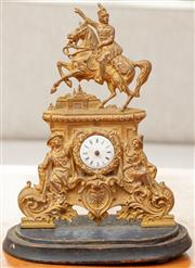 Sale 8976H - Lot 69 - A mid 19th Century Austro-Hungarian gilt brass clock or zappler with an equestrian figure missing hands and glass dome. Height 22cm