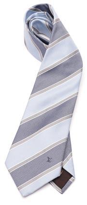 Sale 9080F - Lot 42 - A LOUIS VUITTON TIE IN BOX; pale blue with dark blue and grey stripes, monogrammed LV bottom RH corner, 55% silk 45% cotton.