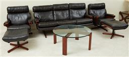 Sale 9097H - Lot 84 - A Palisander and leather lounge suite comprising three seater, two armchairs and two foot stools and glasstop coffee table c. 1970,...