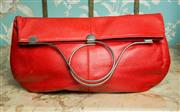 Sale 8420A - Lot 49 - A large vintage 70s red leather clutch with metal hoop handle design, measurements: 37cm wide x 20cm high (closed) 37cm high (open)