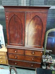 Sale 8598 - Lot 1063 - Early 19th Century Mahogany Press on Chest, with two gothic pointed arch panel doors enclosing slides, above four drawers & on turne...
