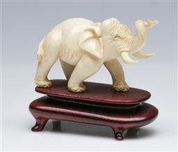 Sale 9093P - Lot 6 - Carved Ivory Elephant on Stand, L 8cm.