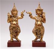Sale 9078 - Lot 15 - Gilt painted Balinese temple dancers (H32cm)