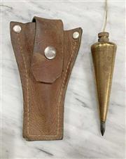 Sale 8951P - Lot 332 - American Brass Carrot Forn Plumb Bob in Leather Sheath (13cm)