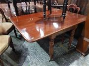 Sale 8939 - Lot 1055 - William IV Mahogany Extension Dining Table, including two leaves, comprising of two independant side table sections, on turned flu...
