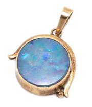 Sale 8991 - Lot 351 - A VINTAGE 9CT GOLD OPAL PENDANT; set with a 13mm wide circular opal doublet, wt. 2.63g.