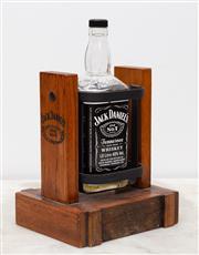 Sale 8644A - Lot 74 - A vintage timber swing cradle Jack Daniels 2L bottle pourer, height of cradle 26cm.