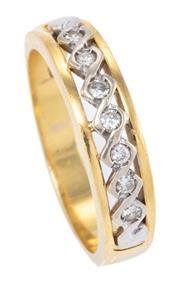Sale 9015J - Lot 64 - AN 18CT GOLD DIAMOND RING; pierced infinity design set with 7 round brilliant cut diamonds, size O, wt. 4.91g.