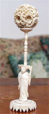 Sale 8963H - Lot 40 - A carved Chinese Ivory woman holding a puzzle ball, Height 21cm