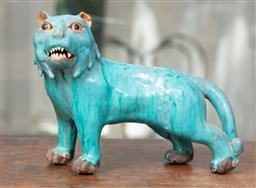 Sale 9120H - Lot 89 - A blue glazed terracotta tiger figure. Length 19cm Chip to ear.