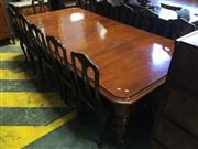 Sale 8653 - Lot 1059 - 19th Century Cedar Extension Dining Table, with two leaves having fastened brass turn clips , on turned faceted legs (with later off...