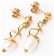Sale 8937 - Lot 378 - A PAIR OF 18CT GOLD PEARL DROP EARRINGS; spiral drops each set with a 10 x 7mm cultured pearl, length 30mm, wt.3.54g.