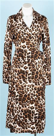 Sale 9083F - Lot 4 - A DIANE VON FURSTENBERG WRAP AROUND DRESS; collared long sleeve wrap dress in 100% silk jersey leopard print, size 10.