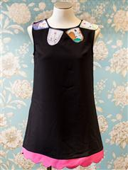 Sale 8474A - Lot 70 - A petite black shift dress, featuring patchwork patterns of womens faces, in excellent condition, size 6