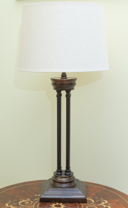 Sale 8677B - Lot 562 - A metal table lamp on column supports over square base with cream shade, Height 76cm