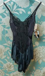 Sale 8420A - Lot 57 - A vintage OLGA black lace frilly teddy, new/never worn, old stock with original tags, size: M