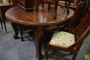 Sale 8465 - Lot 1056 - Timber Seven Piece Dining Setting incl. Round Top Table on Castors with Single Leaf & Six Rail Back Chairs (Winder in Office)