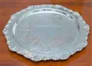 Sale 8341A - Lot 36 - A Strachan silver plate on copper tray with grape and vine border, D 29cm