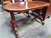 Sale 8598 - Lot 1034 - Victorian Figured Walnut Occasional Table, the oval top on turned end supports joined by a C scroll stretcher