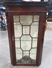 Sale 8939 - Lot 1061 - Georgian Style Mahogany Corner Cabinet, with astragal door, above a timber door with bat-wing corners (missing part of bracket foot)...