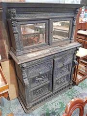 Sale 8939 - Lot 1067 - Late 19th Century Flemish Carved Oak Sideboard, the short top with two mirror panel doors, with arcaded panel doors below. H: 174, W...