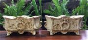 Sale 8706A - Lot 30 - A pair of white colour cast iron planter with laurel wreath H 13 x L 29cm