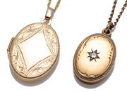 Sale 9074 - Lot 301 - TWO 9CT GOLD LOCKETS; an engraved 23.7 x 16.6mm with vacant lozenge shape cartouche on a 9ct Prince of Wales chain, 55cm, other 13.9...