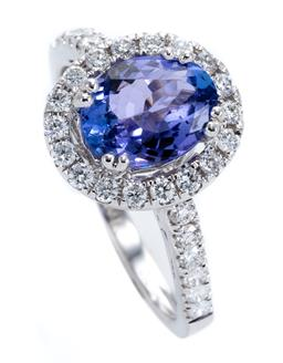 Sale 9213 - Lot 365 - A TANZANITE AND DIAMOND CLUSTER RING; set in 18ct white gold with an approx. 1.50ct tanzanite to surround and upswept shoulders set...