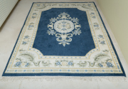 Sale 8677B - Lot 573 - A Chinese carpet with floral motif on blue ground, 234 x 172cm (slight wear)