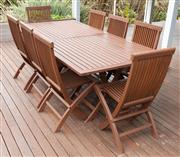 Sale 9023H - Lot 3 - A teak outdoor setting by Cotswold Furniture Collection including two tables and eight chairs, Tables measure Height 73cm x Width 10...
