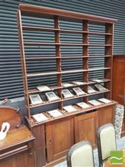 Sale 8428 - Lot 1023 - Large Late 19th Century Cedar Architectural Office Bookcase, the high bookshelf top with shaped uprights, three sliding panel doors...