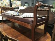Sale 8868 - Lot 1130 - Late 19th Century Cedar Miners Settle, with turned side rails & loose red buttoned cushion