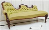 Sale 9090H - Lot 67 - An antique carved chaise longue with green linen upholstery. Height of back 84cm x Length 182cm