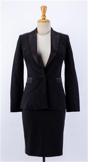 Sale 8891F - Lot 39 - A Colette Dinnigan black wool-blend blazer jacket with satin lapels and sequinned panels, together with a matching skirt, both size XS