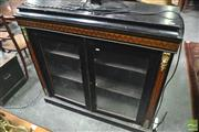 Sale 8317 - Lot 1053 - Late C19th Century French Ebonised & Marquetry Pier Cabinet with two glass panel doors & plinth base