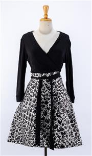 Sale 8891F - Lot 76 - A Diana von Furstenberg black jersey and abstract print wrap dress, size 10