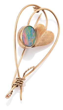 Sale 9149 - Lot 347 - A VINTAGE 9CT GOLD OPAL BROOCH; open frame set with an oval opal doublet, and heart shape leaf tied together with gold twine in the...