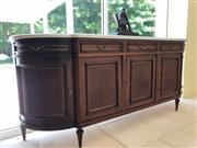 Sale 8677B - Lot 571 - A continental oak marble top four drawer four door buffet with shelved interior raised on tapering legs, H x 104cm, W x 250cm, D x 59cm