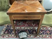 Sale 8868 - Lot 1108 - Late 19th Century French Walnut Envelope Top Card Table, with fruitwood banding, frieze drawer & tapering legs, needs felt lining (K...