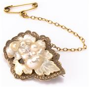 Sale 8937 - Lot 302 - AN ANTIQUE 9CT GOLD PEARL BROOCH; featuring a carved keshi blister pearl cluster in the form of grape vine to 9ct gold engraved sett...