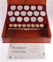 Sale 9035M - Lot 820 - The Sydney 2000 Olympics 24 coin Gold and Silver Millenium Coins Collection fitted in jarrah and oak presentation case containing 8...